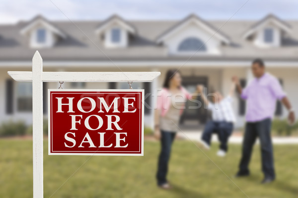 Real Estate Sign and Hispanic Family in Front of House Stock photo © feverpitch