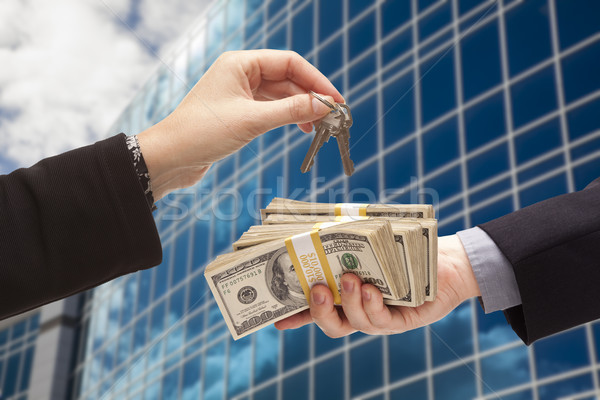 Handing Stack of Cash For Key and Corporate Building Stock photo © feverpitch