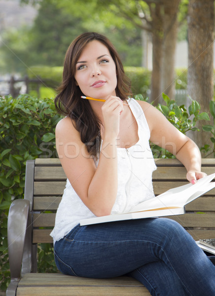 Stock photo: Young Adult Female Student on Bench Outdoors