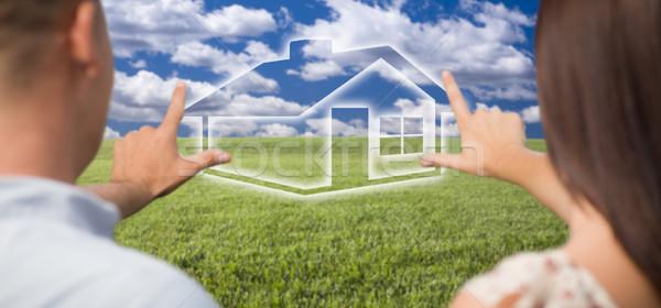 Pareja manos alrededor casa figura campo de hierba Foto stock © feverpitch