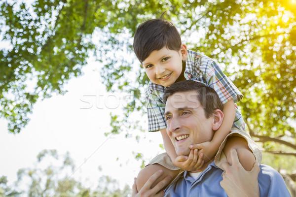 父から息子 演奏 ピギーバック 公園 混血 一緒に ストックフォト © feverpitch