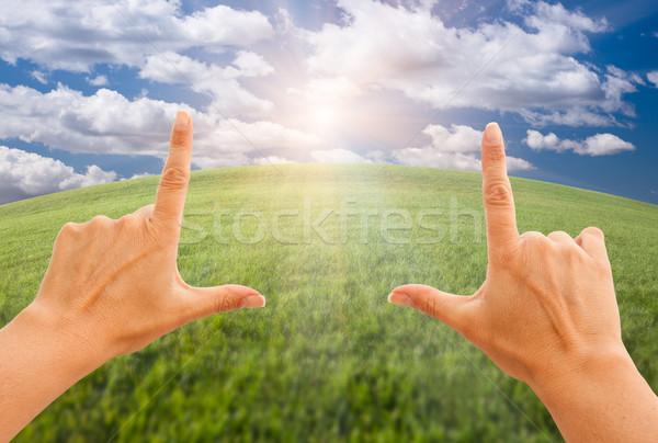Női kezek készít keret fű égbolt Stock fotó © feverpitch