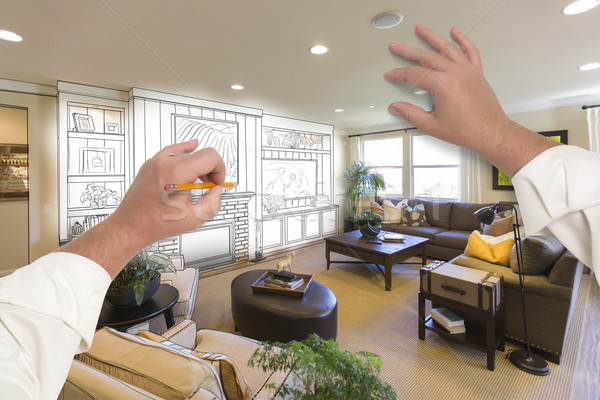 Male Hands Drawing Entertainment Center Over Photo of Home Inter Stock photo © feverpitch