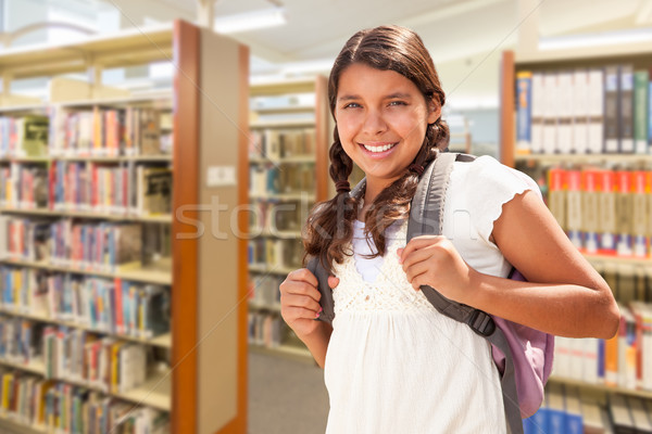 Hispanic Girl Student Walking in Library Stock photo © feverpitch