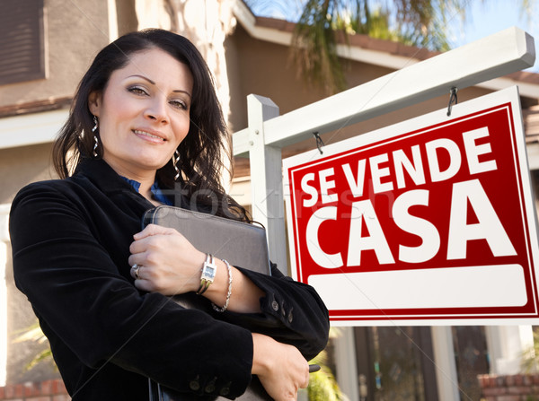 Female Hispanic Real Estate Agent, Se Vende Casa Sign and House Stock photo © feverpitch