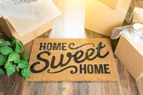 Home Sweet Home Welcome Mat and Moving Boxes on Hard Wood Floor Stock photo © feverpitch