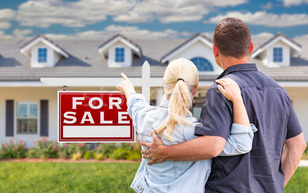 Young Adult Couple Facing and Pointing to Front of For Sale Real Stock photo © feverpitch
