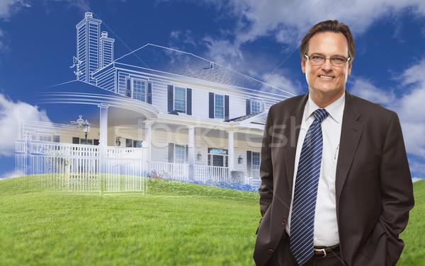 Glimlachend zakenman huis tekening achter foto Stockfoto © feverpitch