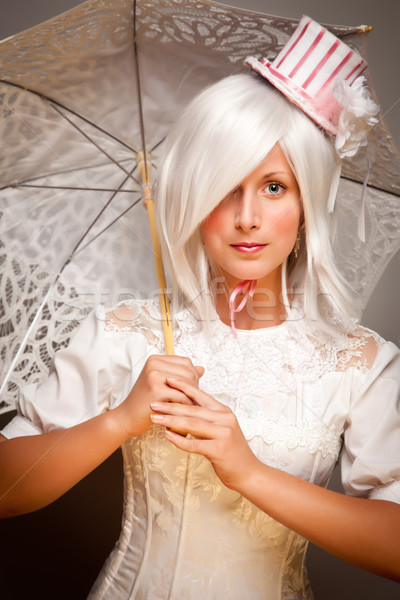 Pretty White Haired Woman with Parasol and Classic Dress Stock photo © feverpitch