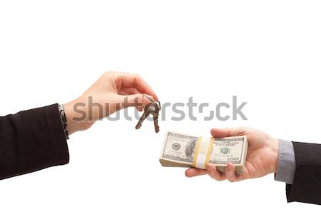 Handing Over Cash For Keys Isolated Stock photo © feverpitch