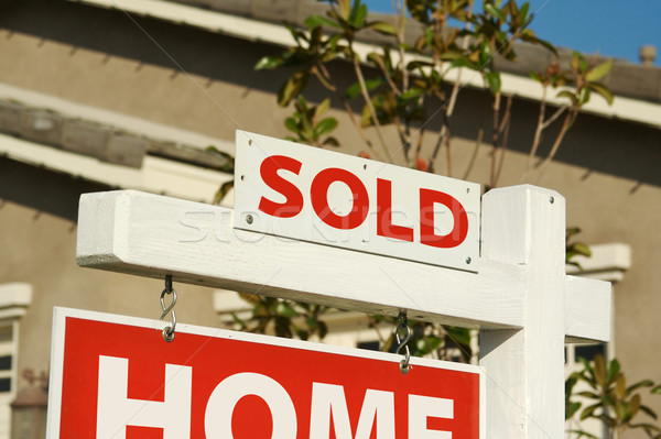 Sold Home For Sale Sign & New House Stock photo © feverpitch