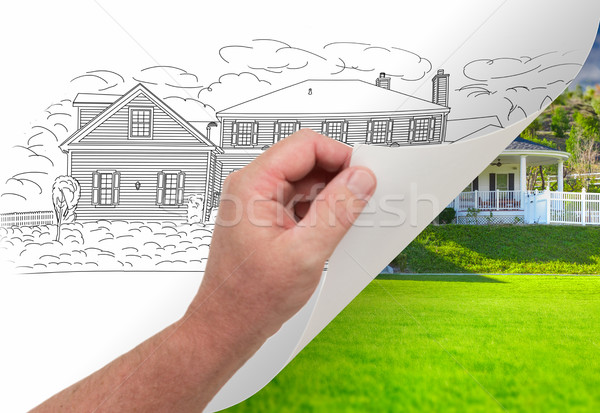 Hand Turning Page of Custom Home Drawing To Photograph Stock photo © feverpitch