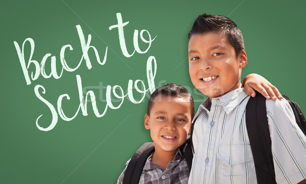 Hispanic Boys Wearing Backpacks In Front of Back To School Writt Stock photo © feverpitch