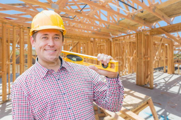 Contractor With Level On Site Inside New Home Construction Frami Stock photo © feverpitch