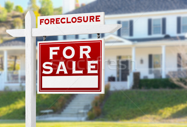 Right Facing Foreclosure For Sale Real Estate Sign in Front of H Stock photo © feverpitch