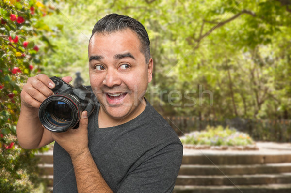 Hispanic Young Male Photographer With DSLR Camera Outdoors Stock photo © feverpitch