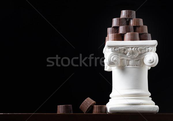 Stack of Fine Artisan Chocolates Stacked On White Pillar Column Stock photo © feverpitch