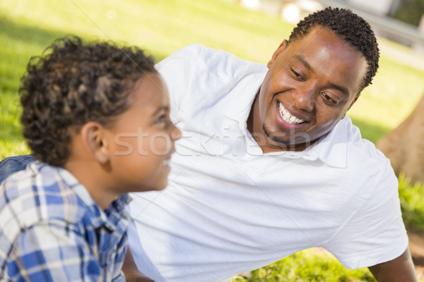 Happy Mixed Race Father and Son Playing Stock photo © feverpitch