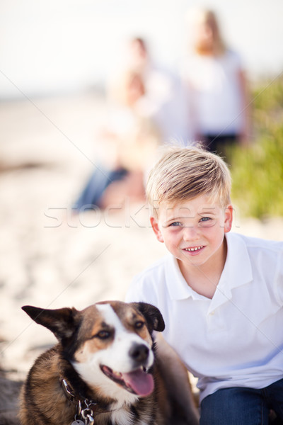 Handsome Young Boy Playing with His Dog Stock photo © feverpitch