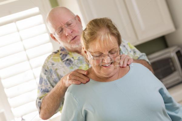 Senior Adult Husband Giving Wife a Shoulder Rub Stock photo © feverpitch