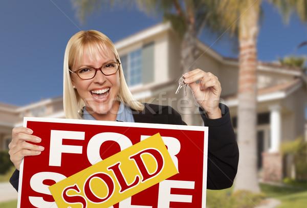 Excitado mujer casa claves vendido Foto stock © feverpitch
