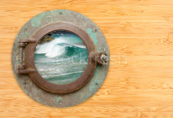 Antique Porthole with View of Crashing Waves on a Bamboo Wall Ba Stock photo © feverpitch