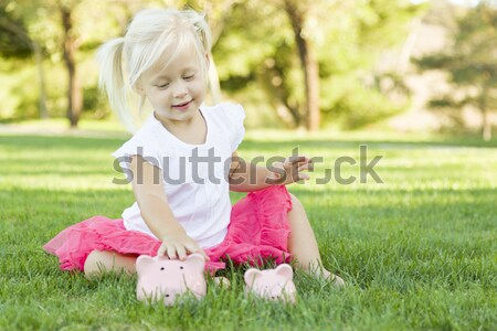 Stock photo: Little Girl In Grass Talking on Cell Phone