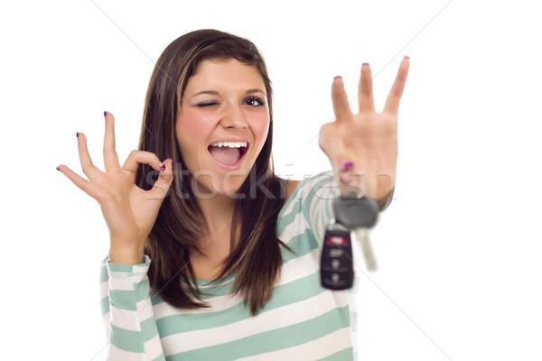 Etnik kadın araba anahtarları tamam el işareti beyaz Stok fotoğraf © feverpitch