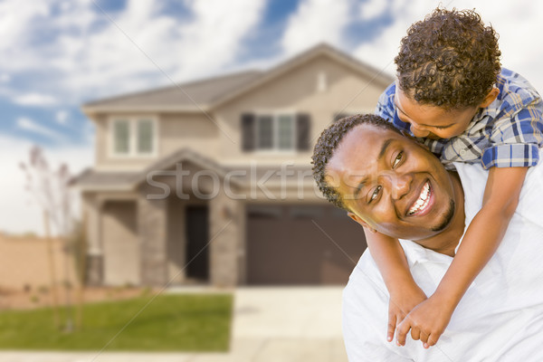 Mixed Race Father and Son In Front of House Stock photo © feverpitch