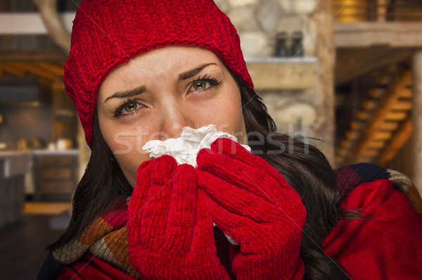 Sick Woman Inside Cabin Blowing Her Sore Nose With Tissue Stock photo © feverpitch