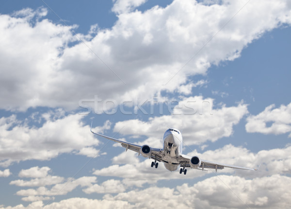 Jet Airplane Landing with Dramatic Clouds Behind Stock photo © feverpitch