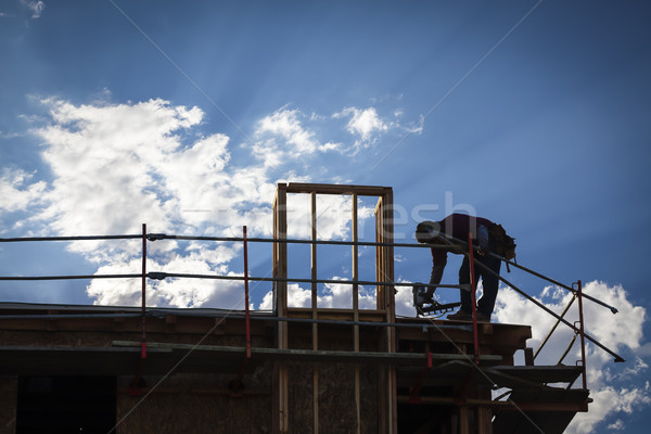 Construction Worker Silhouette on Roof Stock photo © feverpitch