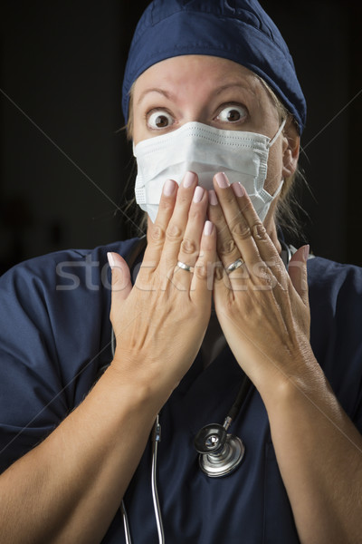 Shocked Female Doctor with Hands in Front of Mouth Stock photo © feverpitch