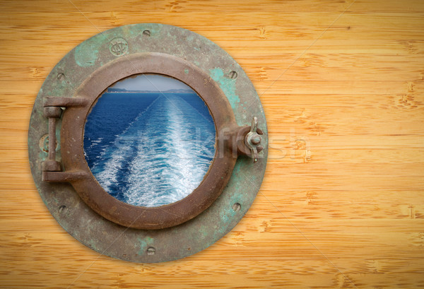 Antique Porthole on Bamboo Wall with View of Ship Ocean Trail Stock photo © feverpitch