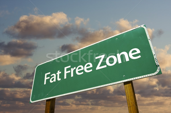 Fat Free Zone Green Road Sign and Clouds Stock photo © feverpitch