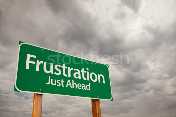 Frustration Green Road Sign Over Storm Clouds Stock photo © feverpitch