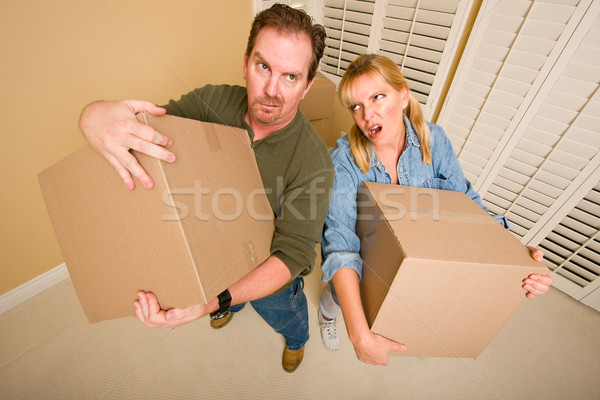 Exhausted Couple Holding Moving Boxes Stock photo © feverpitch