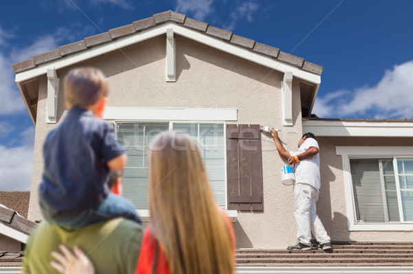 Young Family Watching House Get Painted by Painter Stock photo © feverpitch