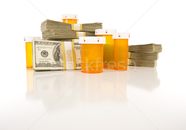 Medicine Bottles and Stacks of Hundreds of Dollars Stock photo © feverpitch