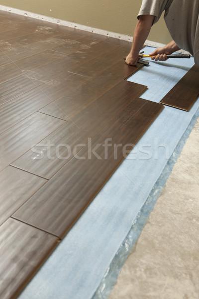 Stock photo: Man Installing New Laminate Wood Flooring