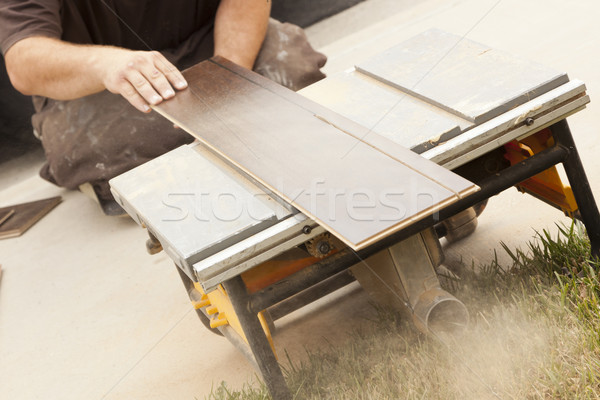 Contractor Using Circular Saw Cutting of New Laminate Flooring Stock photo © feverpitch
