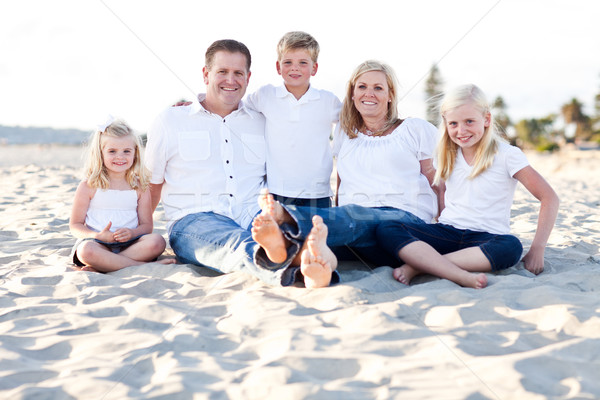 Happy Caucasian Family Portrait at the Beach Stock photo © feverpitch