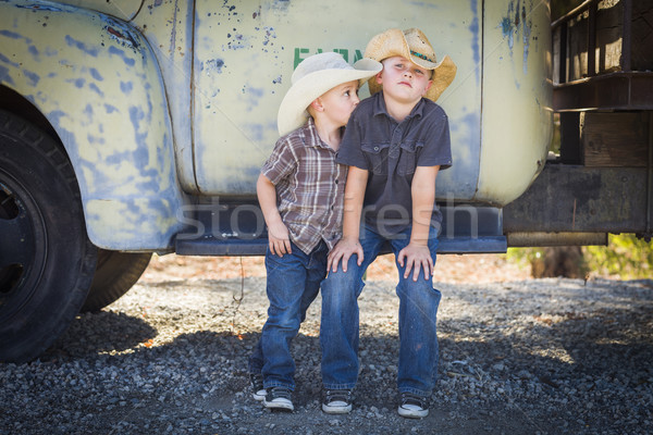 Two Young Boys Wearing Cowboy Hats Leaning Against Antique Truck Stock photo © feverpitch