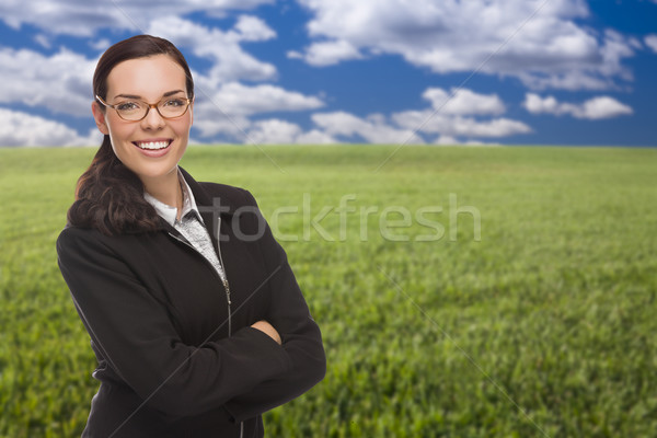 Confident Woman in Grass Field Looking At Camera Stock photo © feverpitch