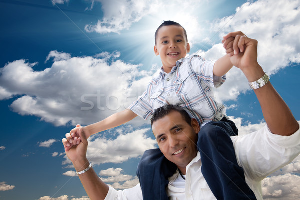 Hispanic Father and Son Having Fun Over Clouds Stock photo © feverpitch