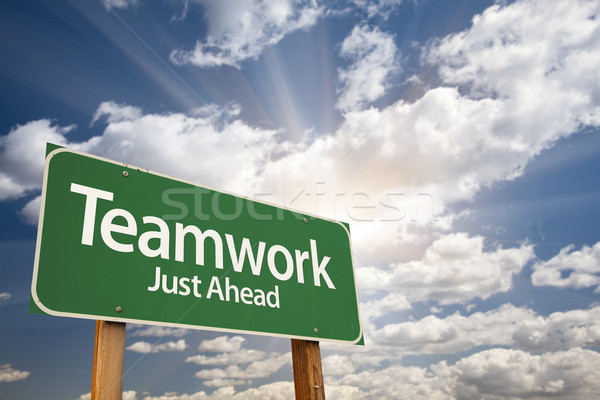 Teamwork Green Road Sign Over Clouds Stock photo © feverpitch