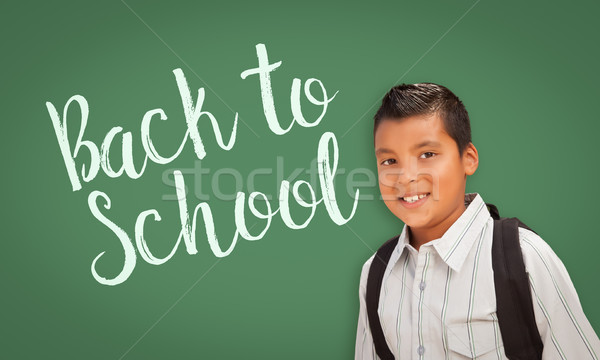 Hispanic Boy In Front of Back To School Chalk Board Stock photo © feverpitch