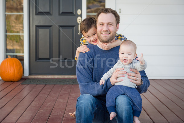Mixed Race Father and Sons on Front Porch Stock photo © feverpitch