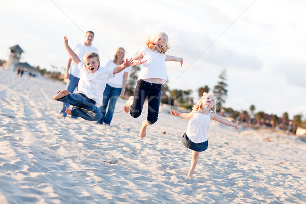 Happy Sibling Children Jumping for Joy Stock photo © feverpitch