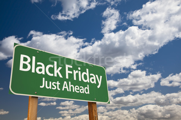 Black Friday Just Ahead Green Road Sign and Clouds Stock photo © feverpitch